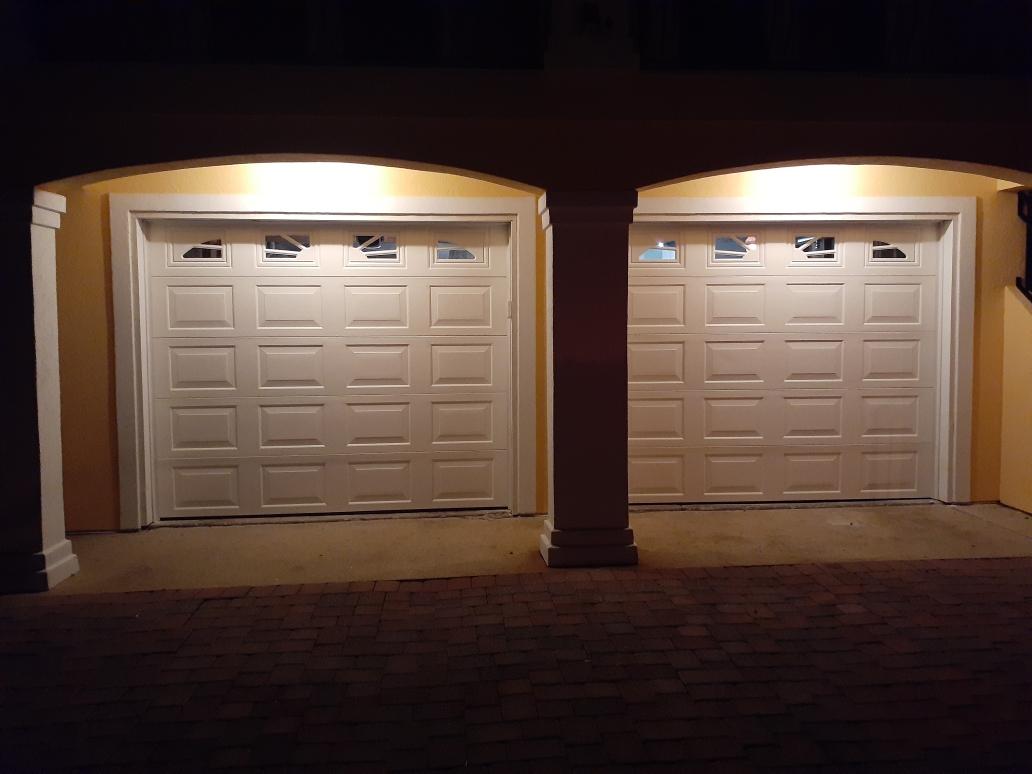 Garage Doors Installation With Sunburst Inserts On