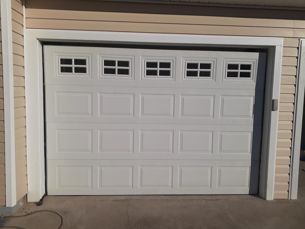 C H I Garage Door Installation With Stockton Window Inserts In Pensacola Fl